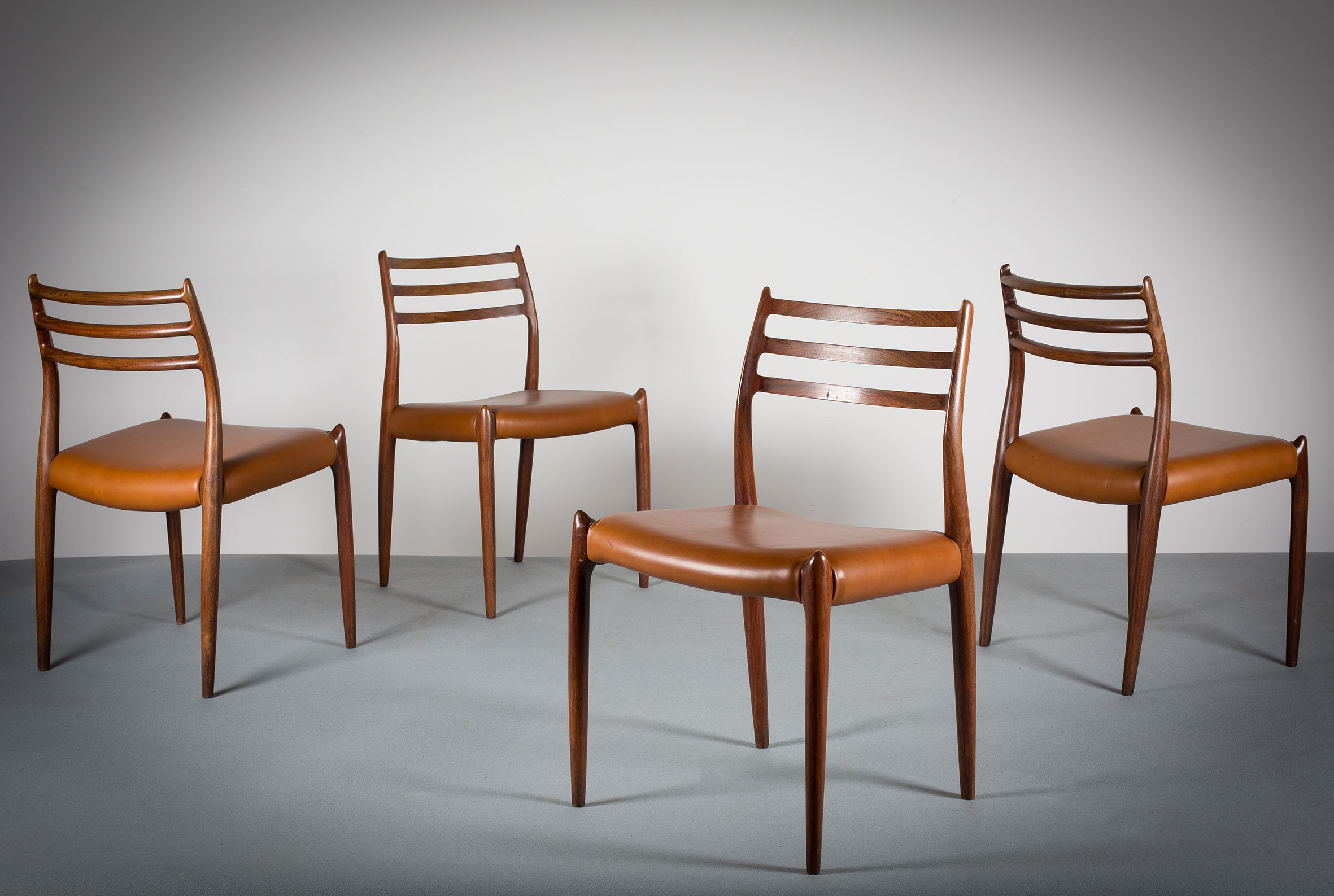 A SET OF FOUR IN ROSEWOOD,